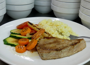 Grilled tuna steak with grilled vegetables and couscous