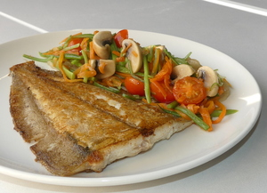Grilled flatfish with sliced roast potatoes and sautéed organic vegetables