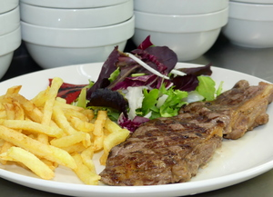 Grilled rib eye with salad and French fries