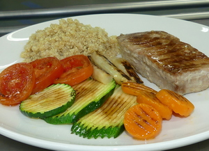 Grilled tuna steak with grilled vegetables and quinoa