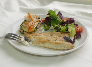 Sea bass with salad and courgette filled with rice and vegetables