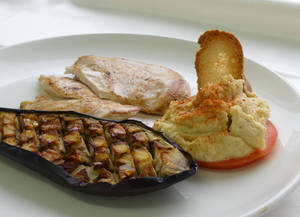 Chicken breast fillets with roasted aubergine and hummus
