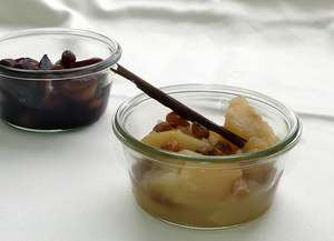 Apple and pear compote with white wine topped with raisins