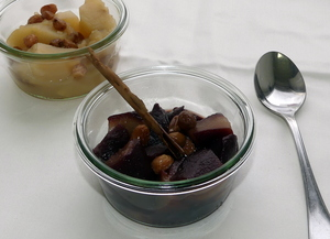 Apple and pear compote with red wine topped with raisins