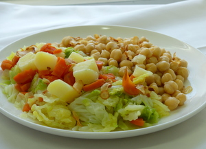Chickpeas with cabbage, potato, carrot and fried garlic